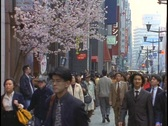 Stock Video Footage of Crowds of pedestrians walk down a sidewalk in the Ginza district of Tokyo,
