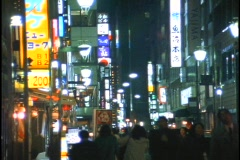 Pedestrians walk down a crowded sidewalk in Tokyo, Japan. Stock Footage