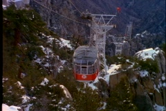 A ski tram moves up the side of a steep mountain in Palm Springs, California. Stock Footage