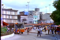 Buses and pedestrians pass by on a busy street in Manaus, Brazil. Stock Footage