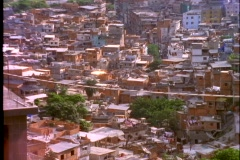 Debris flies in the air over a slum in Rio De Janeiro, Brazil. Stock Footage