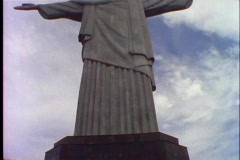 Stock Video Footage of The Christ The Redeemer statue stands over Rio De Janeiro, Brazil.