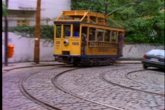 A dog chases a trolley driving through the streets of Rio De Janeiro, Brazil. Stock Footage