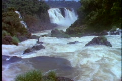The Iguacu Falls fall into a flowing river. Stock Footage