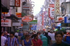 Pedestrians wander through the shopping district of Buenos Aires, Argentina. Stock Footage