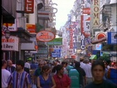 Stock Video Footage of Pedestrians wander through the shopping district of Buenos Aires, Argentina.