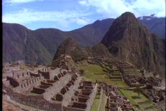 A pan across Machu Picchu Incan ruins in Peru. Stock Footage