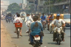 Bike traffic pedals down the streets of Saigon, Vietnam. Stock Footage