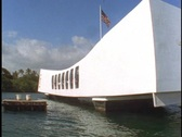 An American flag waves over the USS Arizona Memorial. Stock Footage