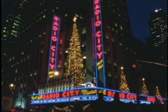 Christmas trees twinkle above Radio City Music Hall. Stock Footage