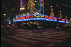 A neon sign lights the entrance of Radio City Music Hall in New York City. Stock Footage