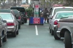 Long lines of cars wait for fuel at the gas pumps. Stock Footage