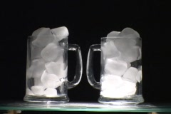 Ice melts in a glass. Stock Footage