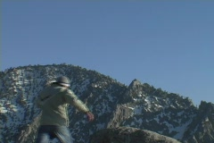 A hiker achieves his victory when he reaches the mountains summit. Stock Footage
