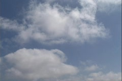 Clouds drift gently in a blue sky. Stock Footage