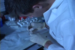 A medical technician performs tests in a lab. Stock Footage