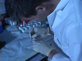 Stock Video Footage of A medical technician performs tests in a lab.