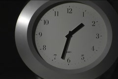 The hands on a clock spin quickly. Stock Footage