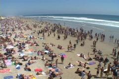 Crowds fill a Malibu beach. Stock Footage