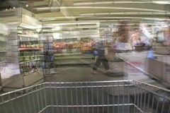 Consumers purchase items in a grocery store. - stock footage