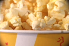 Pan-down of a full container of popped corn. Stock Footage
