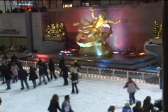 Ice skaters make their way around the Rockefeller Center ice rink in winter. Stock Footage