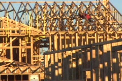 A construction worker works on the framework of a new building. - stock footage