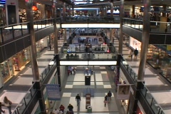 Bird's eye view of people walking through a large shopping mall. - stock footage