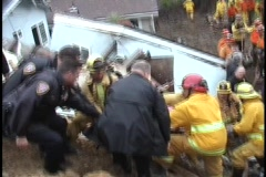 Emergency personnel gently pass a stretcher down a hill. Stock Footage