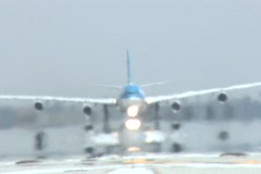 A jet takes off from an airport runway. Stock Footage