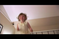 Medium shot of a little girl jump on a bed. Stock Footage
