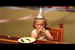 Medium shot of a little girl blowing a party favor. Stock Footage
