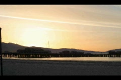 The beach glows with the early morning sun. Stock Footage