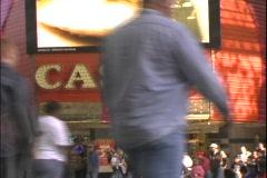 Pedestrians walk past a casino. Stock Footage