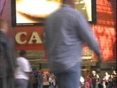 Stock Video Footage of Pedestrians walk past a casino.