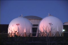 Medium shot of oil storage tanks at an industrial complex. Stock Footage