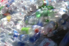 Thousands of plastic bottles pour out of a container in a recycling Stock Footage
