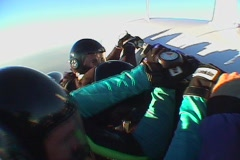 Five skydivers jump out of an airplane and free fall. Stock Footage