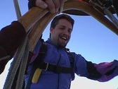 A skydiver falls backwards from a hot air balloon. Stock Footage