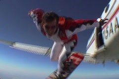 A skydiver jumps from an airplane and performs skyboarding Stock Footage