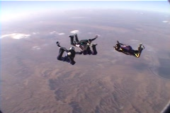 Eight skydivers perform group maneuvers while free-falling. Stock Footage