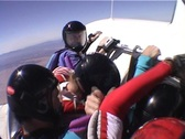 Four skydivers jump from an airplane and perform group maneuvers Stock Footage