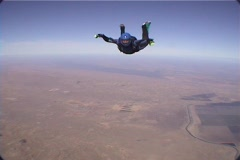 A skydiver free-falls and performs maneuvers. Stock Footage