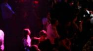 People talking at bar rack in night club Stock Footage