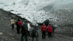 Hikers gather at the base of a glacier for a trek. Stock Footage