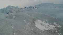 A group of explorers move across a glacier. Stock Footage