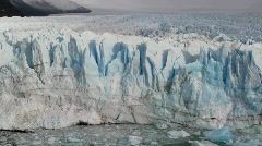 Pan across a vast glacier where it meets the sea. Stock Footage