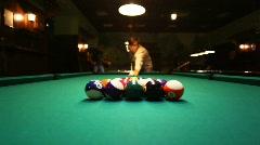 Man in billiards shoots at balls Stock Footage