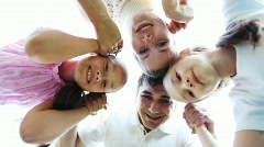 Family with two little girls keeps for hands and then disperses Stock Footage
