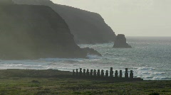 Easter Island statues stand in the distance against the - stock footage